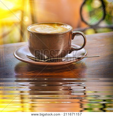 Cup Of Coffee With Reflect In Water