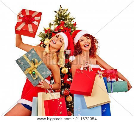 Christmas friends women with shopping bag and gift box having fun together under Xmas tree isolated.