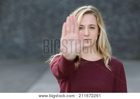 Stern Young Woman Making A Stop Gesture