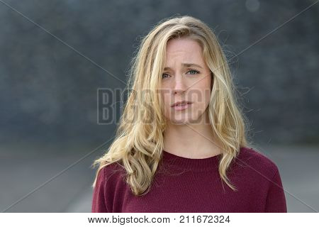 Upset Young Woman With A Sad Expression