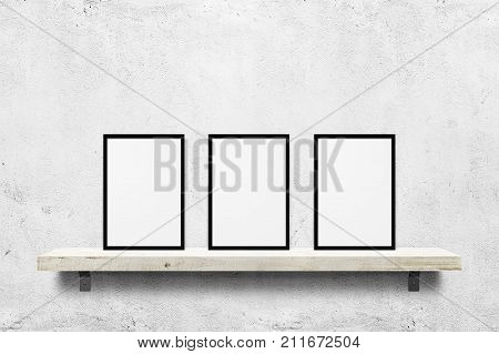 Еркуу цhite blank photo frames mockup on shelf over white concrete wall background