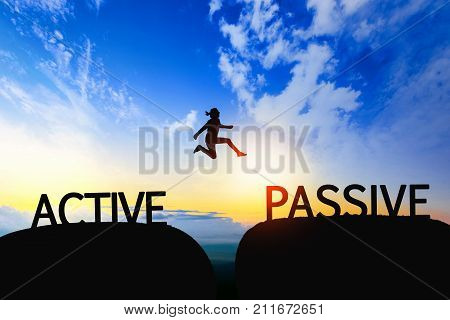 Man jump through the gap between ACTIVE to PASSIVE on sunset.