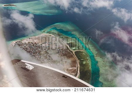 Tropical Islands And Atolls In Maldives In Indian Ocean From Aerial View. Piece Of Paradise On The E