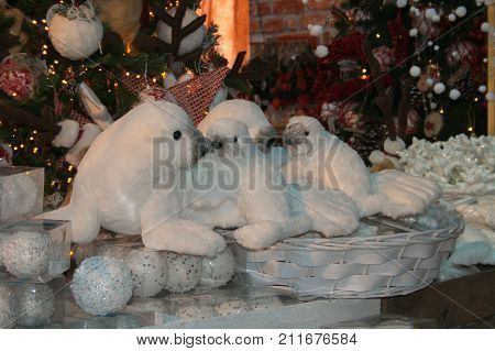 Cute seal toys with Christmas tree background