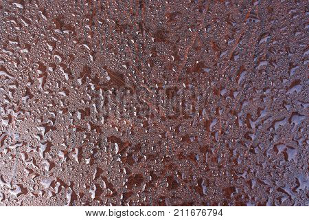 Surface of leatherette with drops of dew