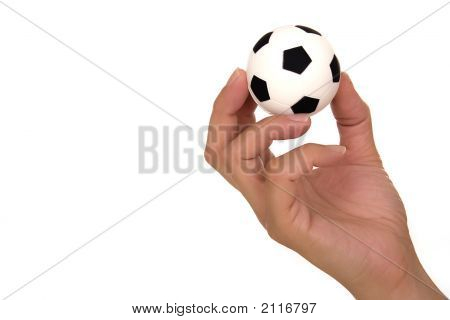 Feminine hand holding miniaturized rubber soccer ball over white background poster