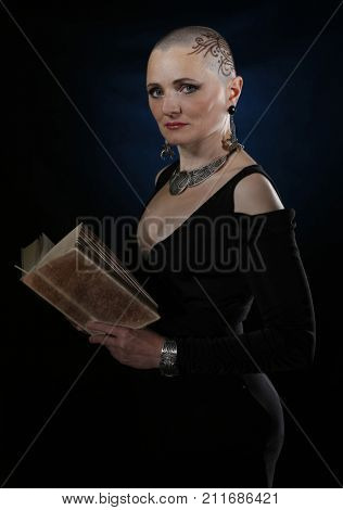 A bald woman with a book. Bald woman