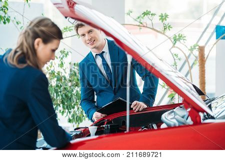 Managers Looking Under Car Hood