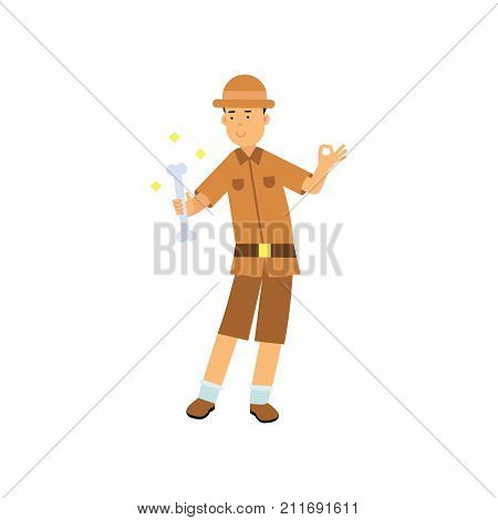 Archaeologist character standing with bone in his hand. Archaeological find. Treasure hunter in brown safari suit and hat. Search of ancient artifact. Excavations and archaeology. Flat vector on white