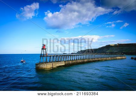 Whitby pier at the harbor entrance at Whitby in North Yorkshire UK
