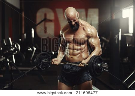 Shot of a shirtless muscular fitness man doing biceps exercises training with EZ curl bar umping iron sport sportsman bodybuilder handsome sexy strong powerful concept