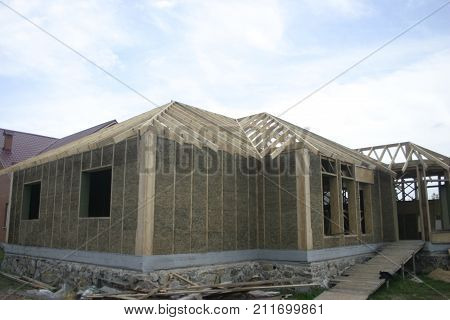 The house is made of a light adobe. Frame-adobe technology. Filling under formwork. Fasade. Roof poster