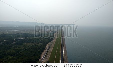 It is a dam in India, Which name is Hirakud Dam ,It is longest dam in Asia.It is about 27 km long.