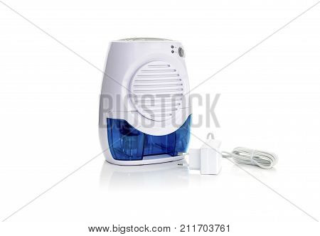 New, portable dehumidifier colect water from air on white background close-up