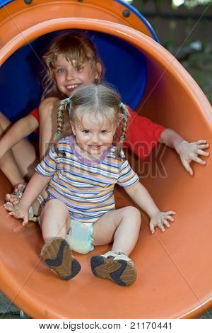 Two children on  waterslide. Vacations.