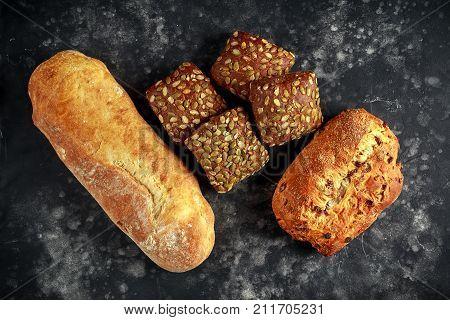 Freshly baked bloomer, ciabatta bread and sandwich buns.