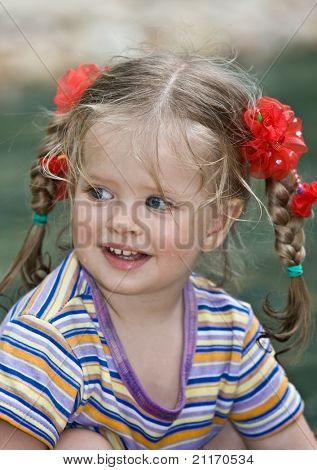 Cute child with long hair. Nature.