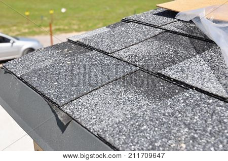 Asphalt Shingles Roof Installation. Install Asphalt Roofing Shingles. Roof Shingles - Roofing Construction House Roofing Repair.
