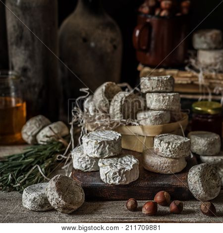 Variety Of French Cheeses In A Dusty Pantry