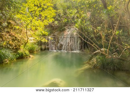 Waterfall at Polilimnio in Peloponnese. A famous touristic destination.