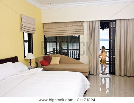 Luxury bedroom with view of sea and girl. Ecotourism.