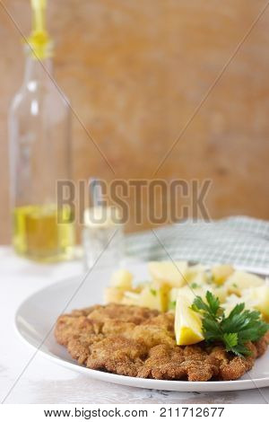 Schnitzel Served With Potato Salad, Lemon. Traditional Austrian Food.