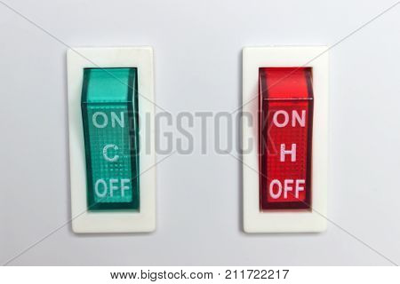Device with two buttons. Switch - on off. Red and green switches.