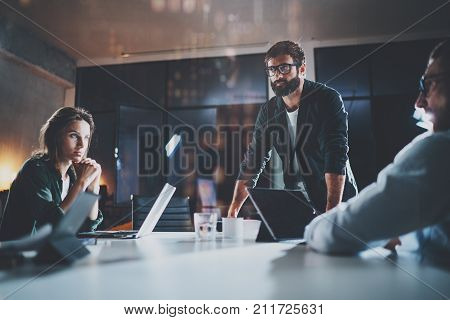 Business people meeting concept.New project team manager making conversation at meeting room with partners at office.Horizontal.Blurred background.Flares