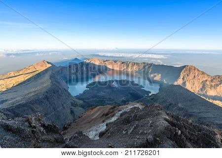 Scenery of Mount Rinjani, active volcano and crater lake from the summit at sunrise, Lombok - Indonesia.