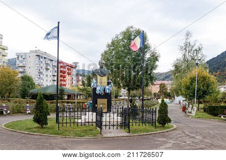Brasov Romania October 06 2017 : Monument to Yitzhak Rabin - the Prime Minister of the State of Israel - established with two flags Israel and Romania in park of Brasov in Romania