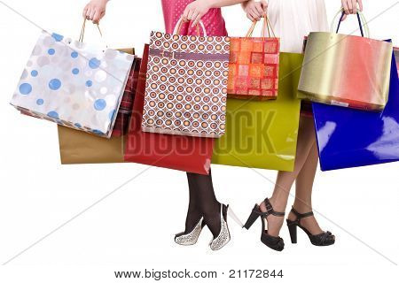 Shopping bag and group of leg in shoes. Isolated.