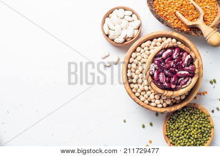 Legumes - lentils chickpeas beans green mung bean on white background. Top view.