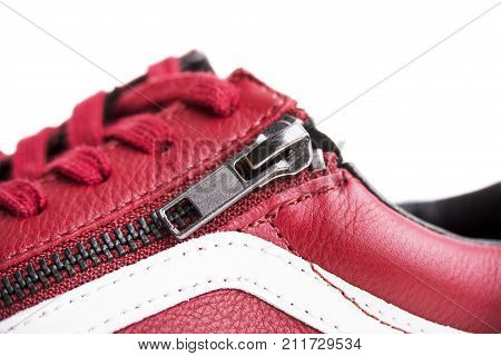Fashion shoes with shoestring. Red sneaker and shoelace isolated on white background