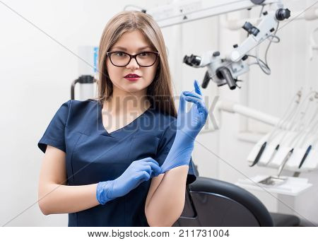Close-up Portrait Of Beautiful Female Dentist At The Morden Dental Office. Doctor Wearing Glasses, B