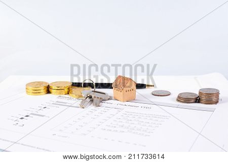 House model on the graph paper for planning your business invesment and realestate concept