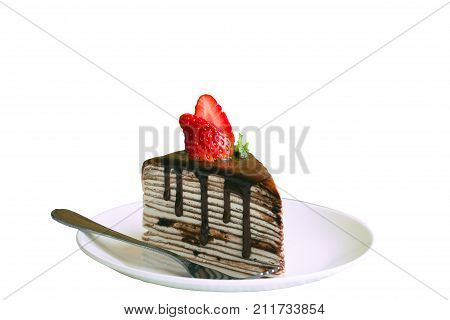 White isolated background with clipping paths homemade chocolate crepe cake or mille crepe cover whipped cream topping dark chocolate sauce,mint,strawberry. Chocolate cake is delicious dessert. Chocolate crepe cake look so yummy