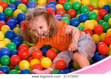 Child girl and  ball group on playground in park.Outdoor.