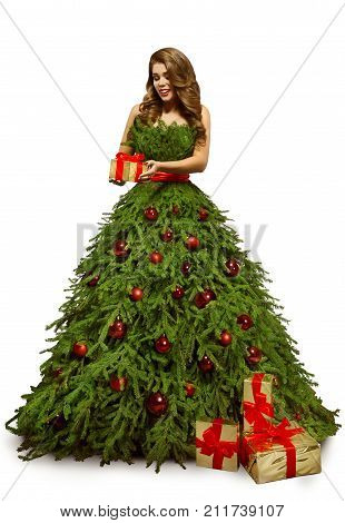 Woman Christmas Tree Dress and Present Gift Fashion Model in New Year Gown Isolated over White background