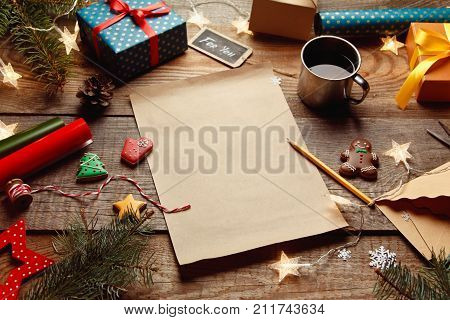 Beautiful Christmas Background With With New Year Décor, A Sheet Of Old Paper, Garland And Gifts On