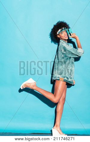 Afro Model In Jeans Jacket With Camera