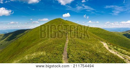 Footpath Through Grassy Peak Of Mountain Ridge