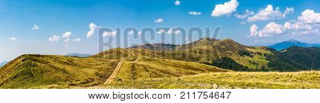 Footpath Through Rolling Hills Of Mountain Ridge