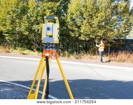 Civil Engineers At Construction Site And A Land Surveyor Using An Altometer Surveyor Equipment Tache