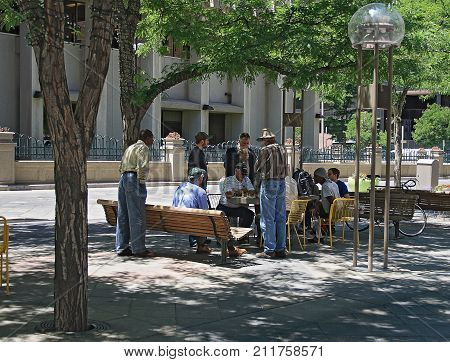 DENVER, COLORADO - JUNE 13, 2008: People relaxing and playing chess in downtown Denver, Colorado