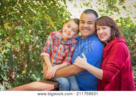 Mixed Race Caucasian and Hispanic Family At The Park.