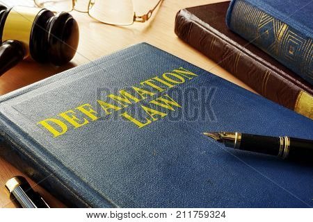 A Book about Defamation Law and gavel.