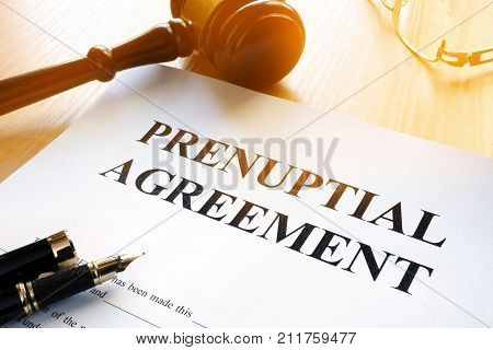 Prenuptial Agreement and gavel on a table.