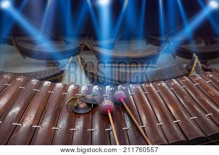 Thai musical instrument (Alto xylophone) with note in thai character on blue luminous rays backgroundasian instrument