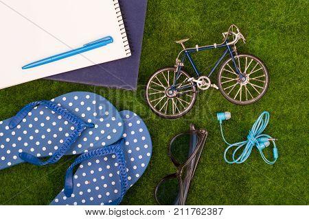 Female Fashion Accessories - Flip Flops, Book, Note Pad, Pen, Headphones, Note Pad, Sunglasses, Toy