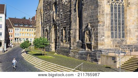 HILDESHEIM, GERMANY - OCTOBER 15, 2017: Panorama of a cobblestoned street at the St. Andreas church of Hildesheim Germany